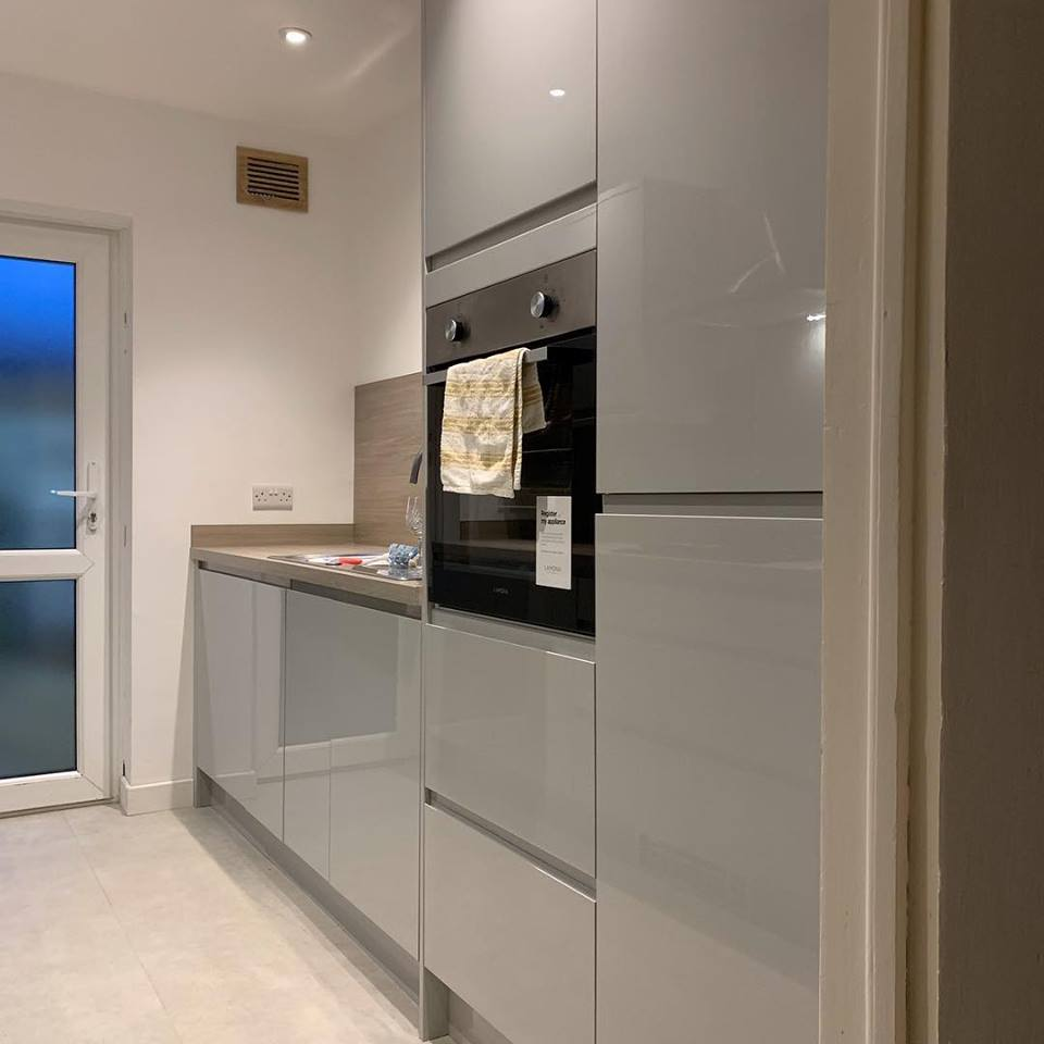silver kitchen units and light wooden work tops